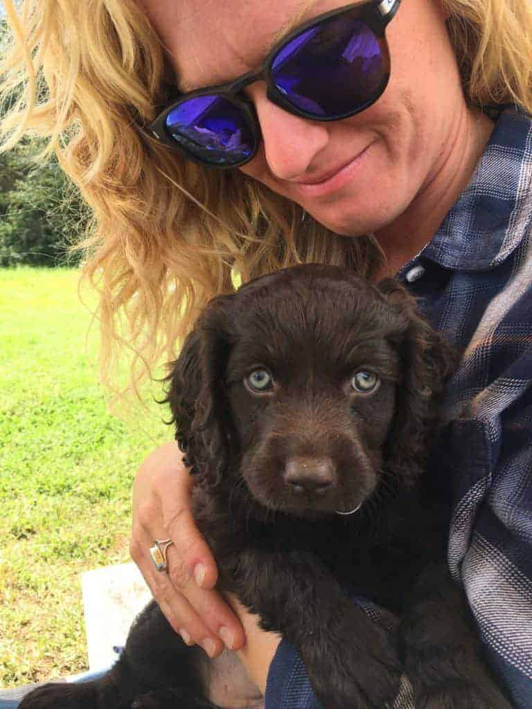 Owner with boykin puppy